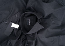 New black colour shirt and blank label stock photos