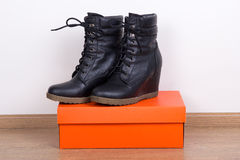 New black female leather boots and box Royalty Free Stock Photos