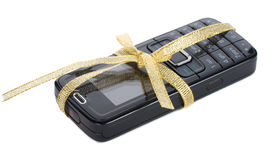 New black mobile phone with gold ribbon Stock Photography