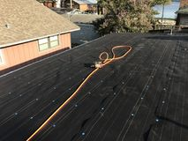 New black roof underlay installed. On roof Stock Photos