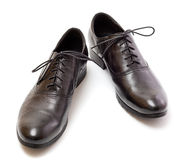 New black shoes. New black shoes with laces on a white background Stock Photo