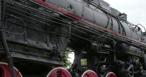 The new black small train in a park FS700 4K RAW Odyssey 7Q. The new black small train displaying in a park FS700 4K RAW Odyssey 7Q stock video