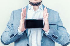 New black smartphone in male hands. Presentation of the new phone. Innovative technologies Stock Photos