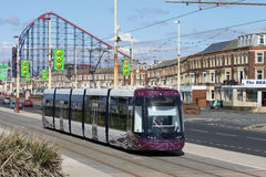 New Blackpool Tram near Pleasure Beach. New Bombadier tram number 010 with a service to Starr Gate on the promenade at Blackpool having just passed the Big One Stock Photos