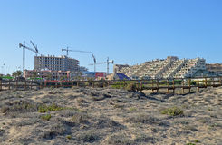 A New Block Of Flats Under Construction Near The Beach - Building Site Houses Royalty Free Stock Images