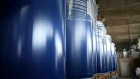 New blue barrels inside a storage warehouse. stock video footage