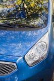 New blue car headlights. New car in showroom, focus on xenon headlights stock image