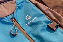 New blue Giordano bag pack and its zip shown to the customer in Blueport shopping mall Hua Hin, Thaiuland February 15, 2019. The New blue Giordano bag pack and stock images