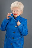 New blue jacket and the woman. Royalty Free Stock Images