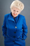 New blue jacket and the woman. Stock Photography