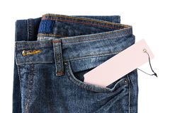 New Blue jeans trouser and tag Royalty Free Stock Images