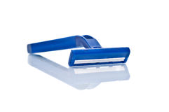 New blue male shaver on white. Background with reflection royalty free stock photography