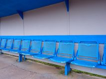 New blue metal seats on outdoor stadium players bench, Royalty Free Stock Photo