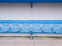 New blue metal seats on outdoor stadium players bench, Royalty Free Stock Photography