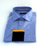 New blue shirt. New shirt still in its wrapping royalty free stock photography