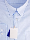 New blue shirt with blank label Royalty Free Stock Image