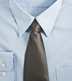 New blue shirt with necktie Royalty Free Stock Images