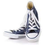 Blue sneakers. New  blue sneakers on white background Royalty Free Stock Photography