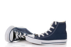 Blue sneakers. New  blue sneakers on white background Royalty Free Stock Image