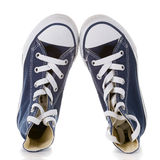 Blue sneakers. New  blue sneakers on white background Royalty Free Stock Images