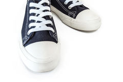 New blue sneakers on white background royalty free stock photography