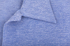 New blue sports shirt. Close-up of a collar Royalty Free Stock Photos