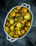 New boiled potatoes with dill and butter in vintage casserole Stock Photography