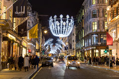 New Bond Street in London at Christmas. LONDON, UK - 23RD DECEMBER 2015: A view down New Bond Street in London during the Christmas period showing building Royalty Free Stock Photos