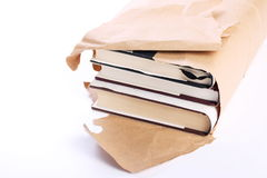 New Books. Open parcel of new hardback books on white background Stock Image
