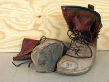 New boots please. A very worn out pair of work boots Royalty Free Stock Photography