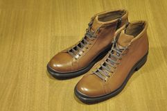 New Boots on a Wooden Floor Royalty Free Stock Images