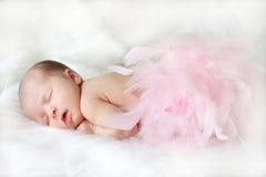 New Born. Baby sleeping on a soft white blanket Stock Photos
