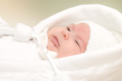 New born. Baby girl dressed in white stock photo