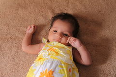 New born asian baby girl in cute dress Royalty Free Stock Images