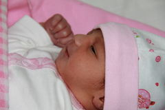 New born asian baby girl in pink cloths. New born baby girl in pink cloths. Baby is 24 hour old. Asian baby girl Stock Photos