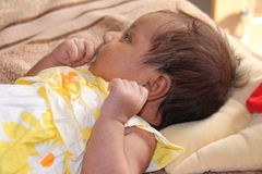 New born asian baby girl thinking Stock Photo