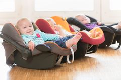 New-born babies in toddler group lying in baby shells. Infants in toddler group lying in baby shells Royalty Free Stock Images