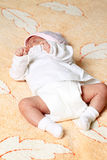 New born baby. Girl peacefully sleeping Stock Photography