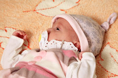 New born baby. Girl peacefully sleeping Royalty Free Stock Images