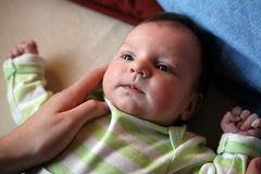 New-born baby. A face of A new born baby and her mother's hand Royalty Free Stock Photos