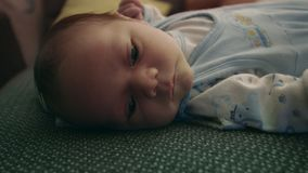 New born baby, child on the bed stock footage