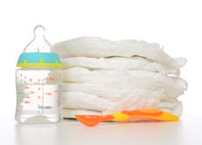 New born baby child stack of diapers spoon baby Royalty Free Stock Photography