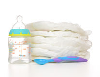 New born baby child stack of diapers spoon Stock Images