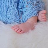 New born baby feet. Close up picture of new born baby feet stock photos