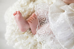 New born baby feet. On a white blanket stock images