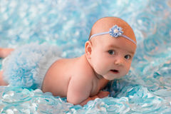 New born baby girl. New born baby a blue background stock image