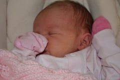 New born baby girl with dark hair Royalty Free Stock Photo