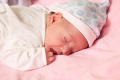 New born baby. Girl peacefully sleeping Royalty Free Stock Photo
