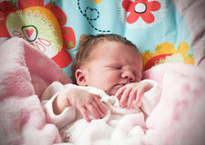 New born baby girl sleeping Stock Images