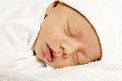 New born baby girl sleeping peacefully Stock Photo